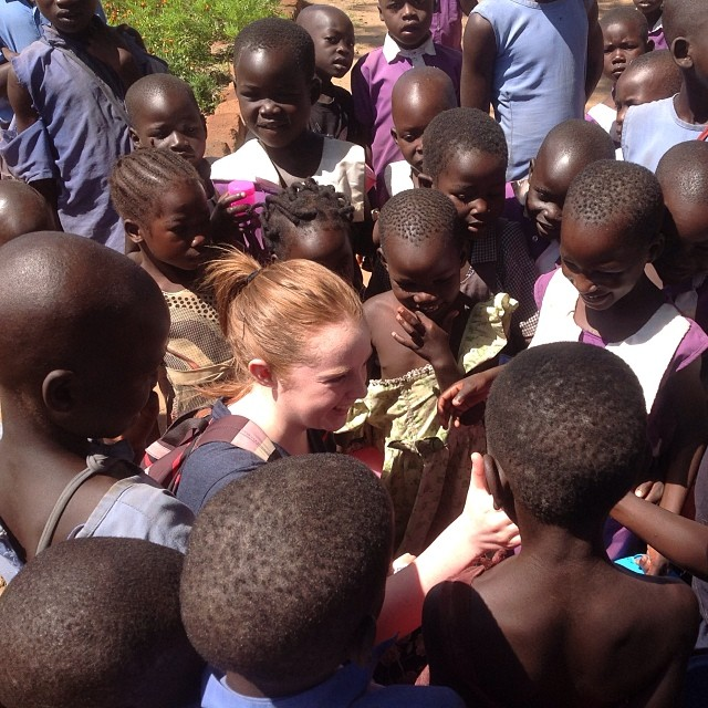 An edukid volunteer with Ugandan children